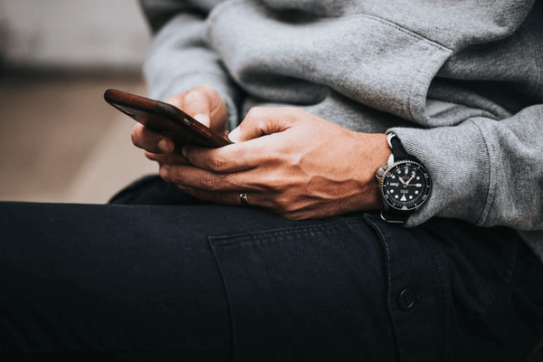 Is Bumble for Over 40s - man on phone using dating app