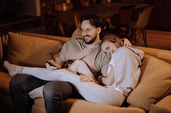 Is A Movie At Home A Good First Date - couple on the couch